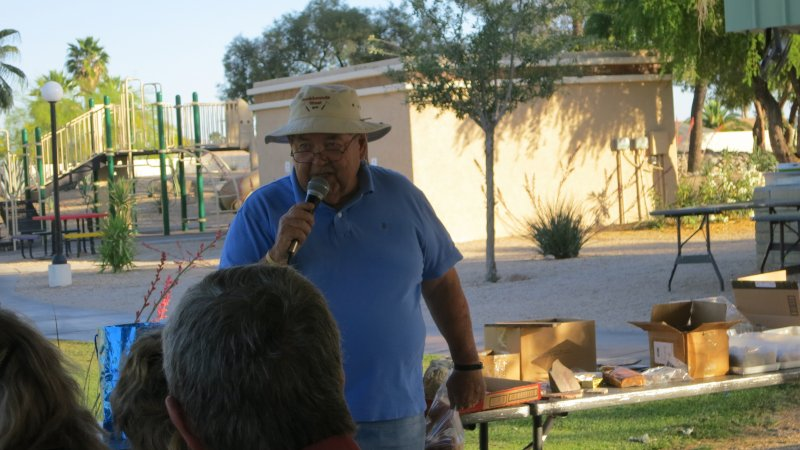 Our auctioneer.....Roy....with the club's hat displaying a logo by Ron Radda